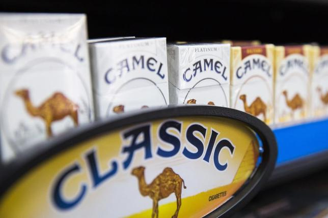Camel cigarettes are stacked on a shelf inside a tobacco store in New York July 11, 2014. REUTERS/Lucas Jackson