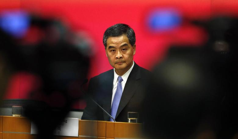 Hong Kong Chief Executive Leung Chun-ying looks on in between video cameras during a news conference in Hong Kong July 15, 2014.    REUTERS/Bobby Yip