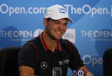 Martin Kaymer of Germany smiles during a news conference ahead of the British Open Championship at the Royal Liverpool Golf Club in Hoylake, northern England July 15, 2014.  REUTERS/Phil Noble