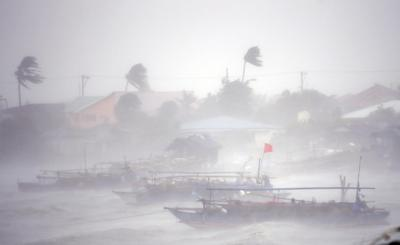 Typhoon kills 10 in Philippines but eases before...