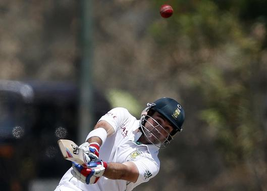 South Africa's Dean Elgar hits a six during the first day of their first test cricket match against Sri Lanka in Galle July 16, 2014. REUTERS/Dinuka Liyanawatte