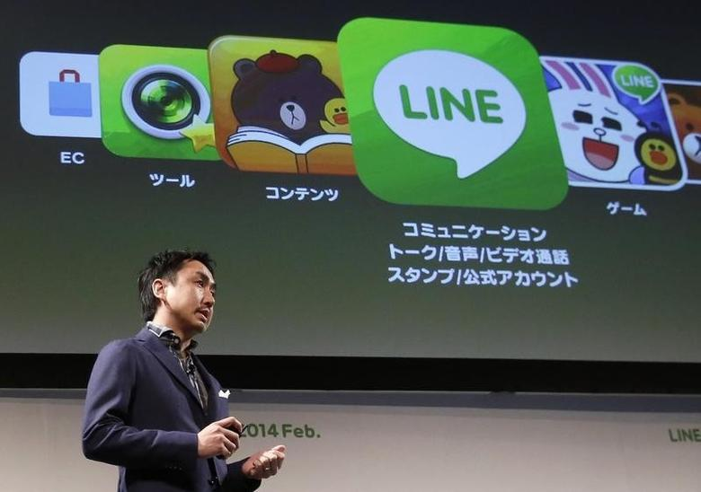 Takeshi Idezawa, chief operating officer of Line Corp, speaks during an announcement of its new service in Tokyo February 26, 2014.   REUTERS/Yuya Shino