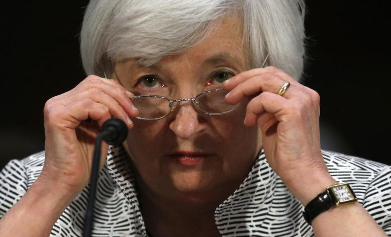 U.S. Federal Reserve Chair Janet Yellen adjusts her glasses as she testifies before the Senate Banking Committee on Capitol Hill in Washington July 15, 2014. REUTERS/Kevin Lamarque