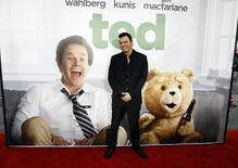 "Writer, director and cast member Seth MacFarlane poses at the premiere of ""Ted"" at the Grauman's Chinese theatre in Hollywood, California June 21, 2012.  REUTERS/Mario Anzuoni"