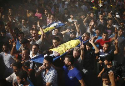 Shelling kills four boys on Gaza beach; Israel, Hamas...