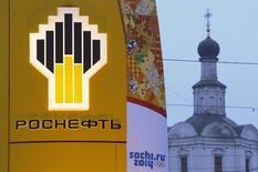 Les Etats-Unis ont imposé mercredi de nouvelles sanctions économiques à la Russie en raison de la crise ukrainienne, visant notamment les banques Gazprombank et Vnecheconombank ainsi que la compagnie pétrolière Rosneft (photo). /Photo prise le 12 novembre 2013/REUTERS/Maxim Shemetov