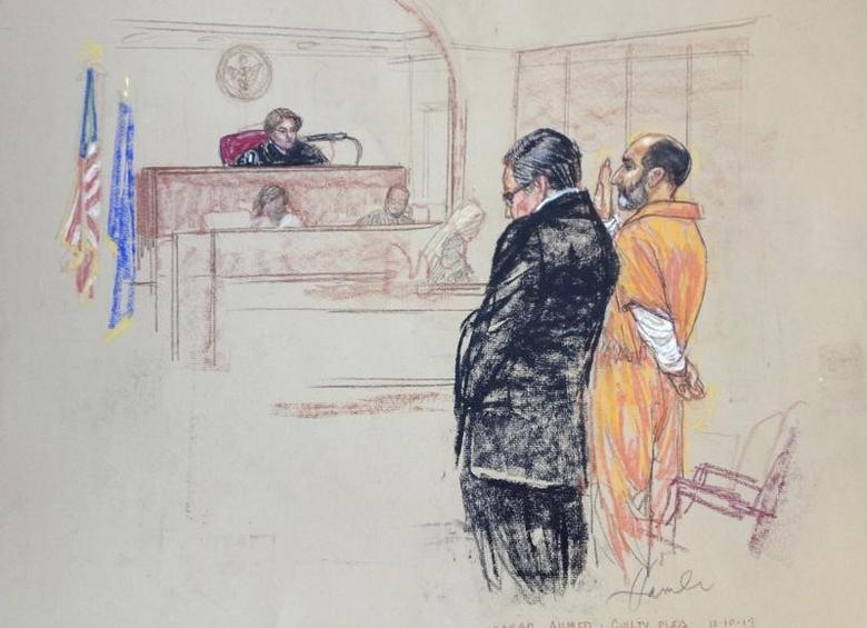 Babar Ahmad (R), a British national accused of operating a website that promoted jihad and supported al Qaeda, is pictured as he pleads guilty in this courtroom sketch in the U.S. District Court in New Haven, Connecticut December 10, 2013.  REUTERS/Janet Hamlin