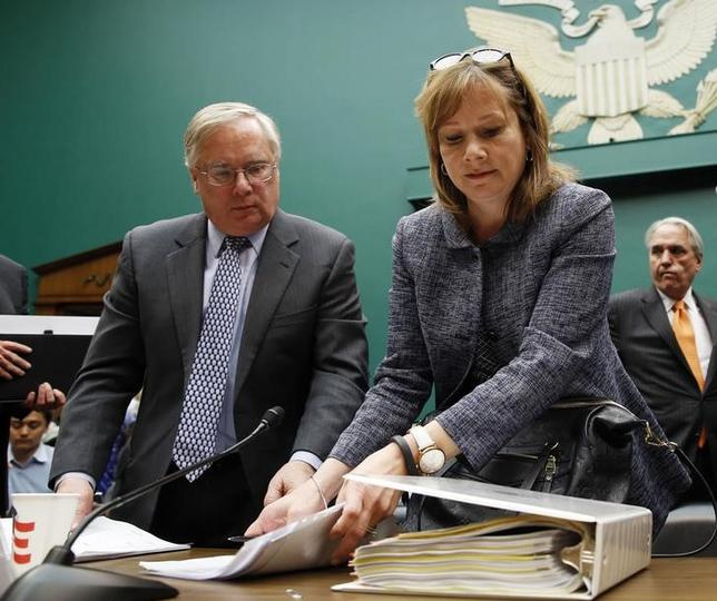 Michael Millikin (L), GM's general counsel since 2009 and a key counselor to Chief Executive Mary Barra (C) looks on as Barra gets ready to depart after testifying on Capitol Hill in Washington in this April 1, 2014 file photo.  REUTERS/Kevin Lamarque/Files