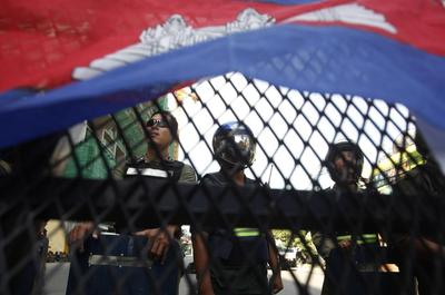 Cambodia arrests more opposition members after violent...