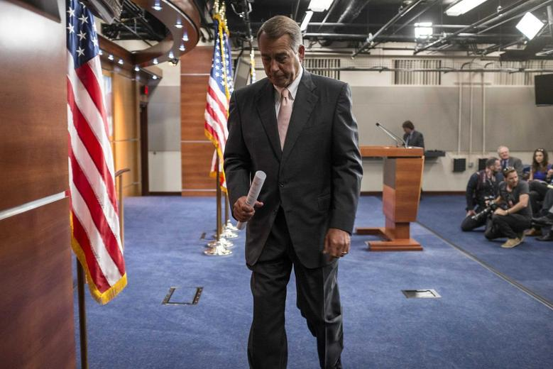 Speaker of the House John Boehner (R-OH) walks from the podium after speaking to the media on Capitol Hill in Washington July 10, 2014. REUTERS/Joshua Roberts