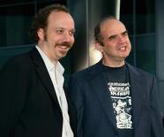 """Actor Paul Giamatti (L) star of the film """"American Splendor"""" arrives for the film's premiere in Hollywood August 7, 2003 with comic book creator Harvey Pekar.  REUTERS/Fred Prouser"""