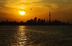 The sun rises over the CN tower and the skyline in Toronto, in this July 19, 2013, file photo.  REUTERS/Mark Blinch