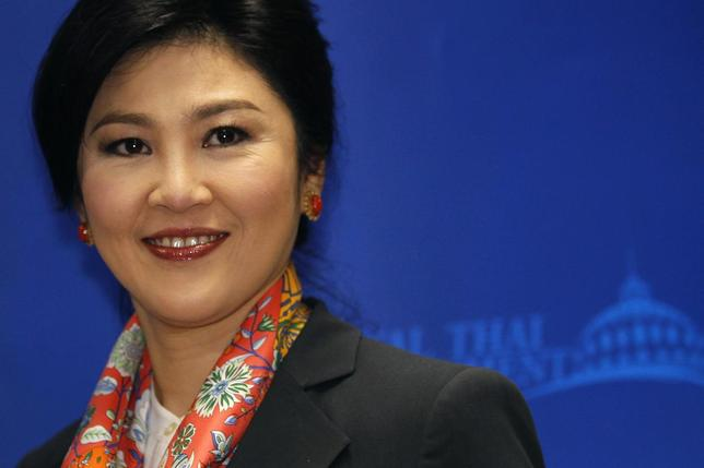 Thailand's Prime Minister Yingluck Shinawatra smiles as she arrives to address reporters in Bangkok in this May 7, 2014 file photo.     REUTERS/Chaiwat Subprasom/Files