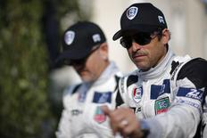 U.S. actor Patrick Dempsey gestures during a parade on the eve of the 82th 24-hours Le Mans endurance race in Le Mans, June 13, 2014. REUTERS/Stephane Mahe