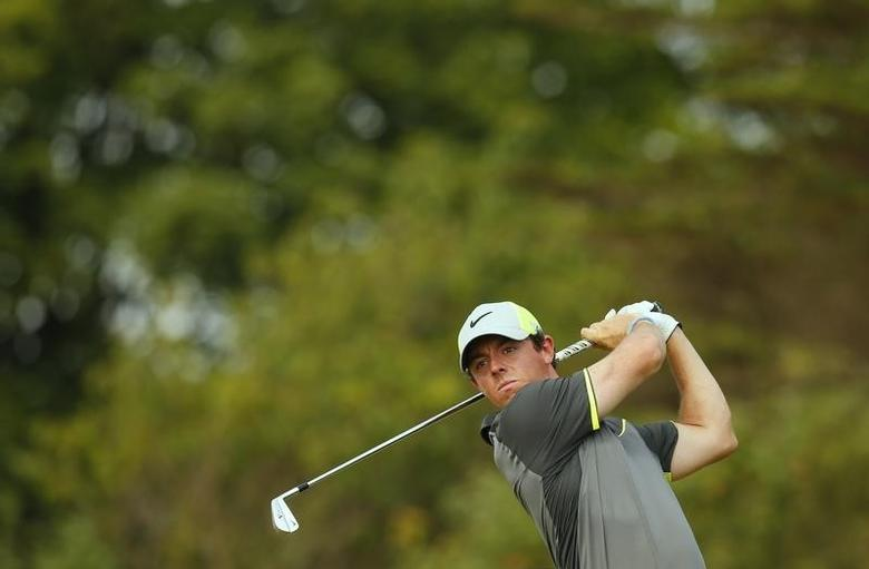 Rory McIlroy of Northern Ireland watches his tee shot on the eighth tee during the second round of the British Open Championship at the Royal Liverpool Golf Club in Hoylake, northern England July 18, 2014.          REUTERS/Cathal McNaughton