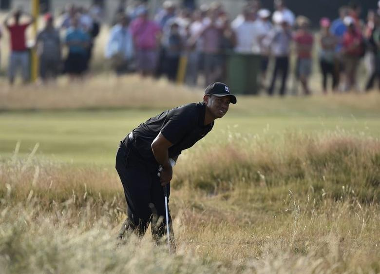 Tiger Woods of the U.S. reacts after his third shot on the 16th hole during the second round of the British Open Championship at the Royal Liverpool Golf Club in Hoylake, northern England July 18, 2014.      REUTERS/Toby Melville