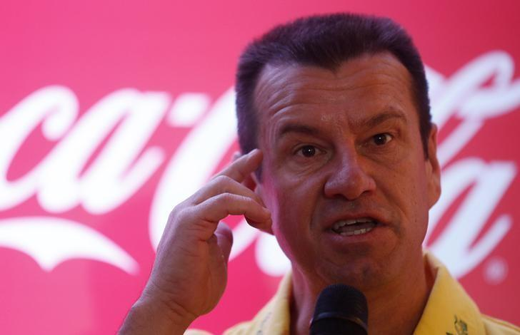 Former soccer player Brazil's Dunga attends a news conference concerning the 2014 World Cup, in Rio de Janeiro July 3, 2014.   REUTERS/Pilar Olivares