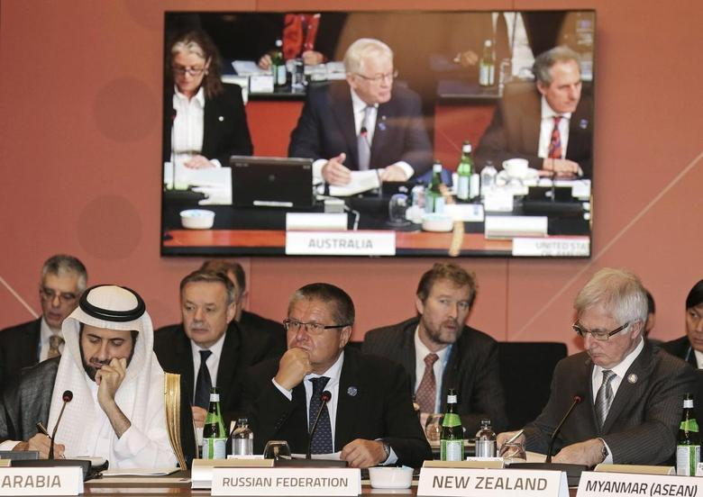 Saudi Arabia's Commerce and Industry Minister Tawfig bin Fouzan Al-Rabiah (L), Russia's Economic Development Minister Alexei Ulyukaev (C) and New Zealand's Trade Minister Tim Groser (R) listen as Australia's Trade and Investment Minister Andrew Robb (not pictured) makes his opening remarks during the G20 Trade Ministers meeting in Sydney July 19, 2014.    REUTERS/Rob Griffith/Pool