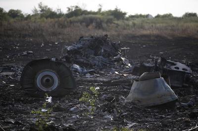 Ukraine, rebels argue over wreck; Europeans give Putin...