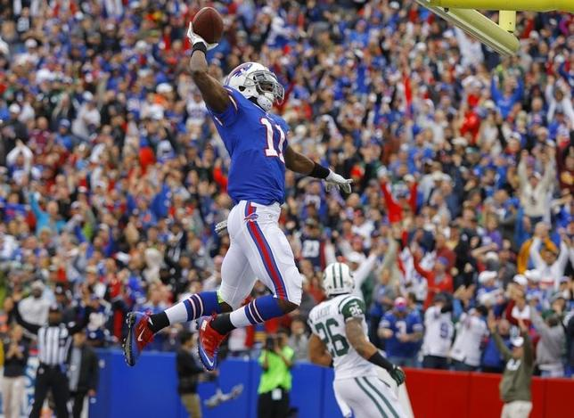 Nov 17, 2013; Orchard Park, NY, USA; Buffalo Bills wide receiver T.J. Graham (11) celebrates his first half touchdown against the New York Jets at Ralph Wilson Stadium. Mandatory Credit: Timothy T. Ludwig-USA TODAY Sports