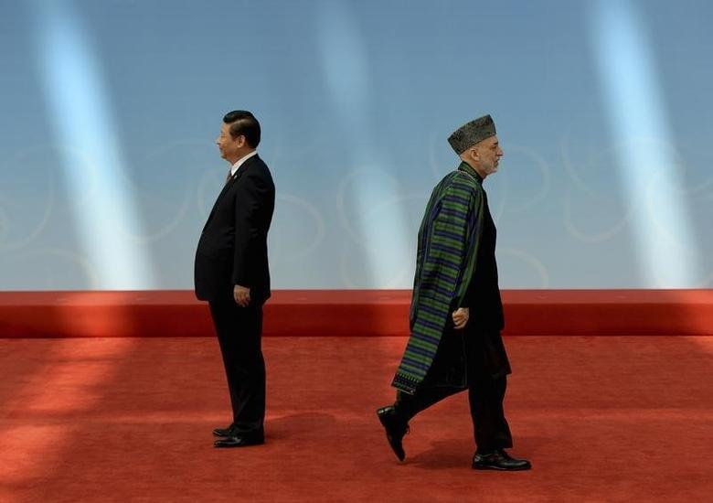 Afghanistan's President Hamid Karzai (R) leaves after shaking hands with his Chinese counterpart Xi Jinping before the opening ceremony of the fourth Conference on Interaction and Confidence Building Measures in Asia (CICA) summit in Shanghai May 21, 2014. REUTERS/Mark Ralston/Pool