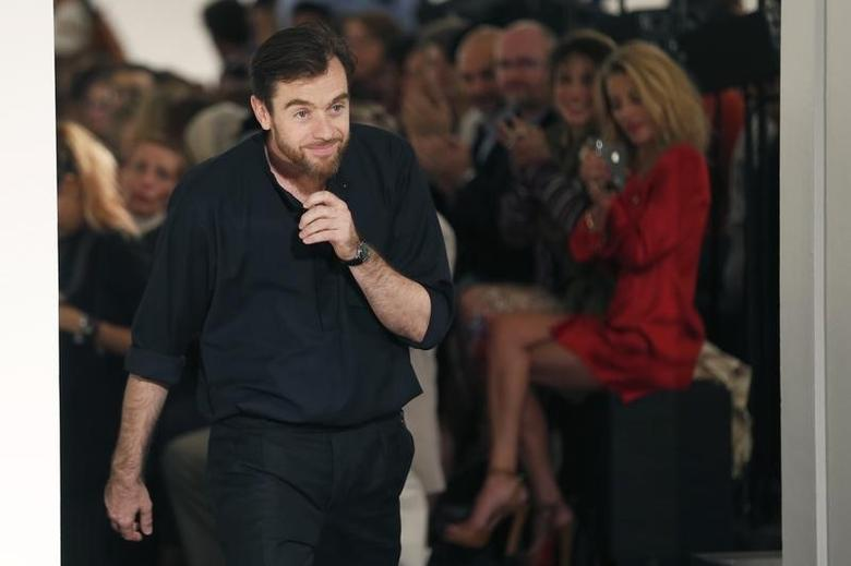 French designer Christophe Lemaire appears at the end of his Spring/Summer 2013 women's ready-to-wear fashion show for fashion house Hermes during Paris fashion week September 30, 2012. REUTERS/Charles Platiau/Files