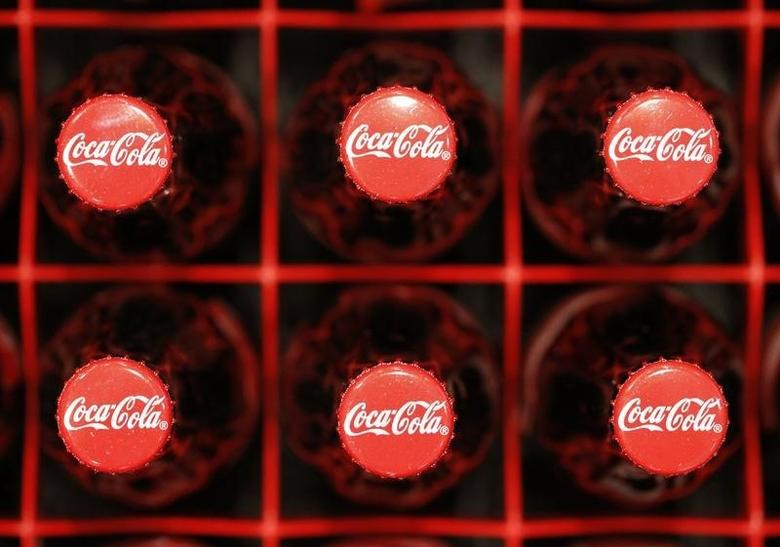 Logos are seen on Coca-Cola bottles in Zurich, February 16, 2011. REUTERS/Christian Hartmann