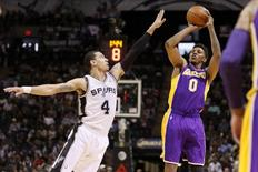 Los Angeles Lakers forward Nick Young (0) shoots the ball over San Antonio Spurs guard Danny Green (4) during the first half at AT&T Center. Apr 16, 2014; San Antonio, TX, USA; Soobum Im-USA TODAY Sports
