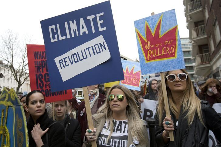 Demonstrators hold placards during an anti-fracking protest in central London March 19, 2014. REUTERS/Neil Hall