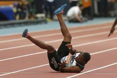 Yohan Blake of Jamaica falls injured in the men's 100m during the IAAF Diamond League athletics meeting at Hampden Park in Glasgow July 11, 2014. REUTERS/Phil Noble