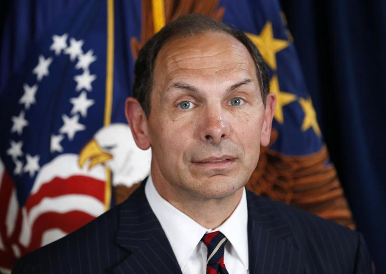 Former Procter & Gamble Chief Executive Bob McDonald, an Army veteran, listens as U.S. President Barack Obama announces McDonald as his nominee to be the next secretary of veterans affairs at the VA in Washington June 30, 2014 file photo.REUTERS/Kevin Lamarque