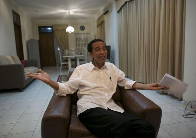 Indonesia's presidential candidate Joko ''Jokowi'' Widodo gestures during an interview with Reuters in Jakarta July 19, 2014.  REUTERS/Darren Whiteside