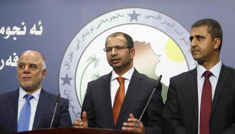 Salim al-Jabouri (C), new speaker of the Iraqi Council of Representatives, and the two deputy speakers Haidar Abadi (L), a Shi'ite member of Iraqi Prime Minister Nuri al-Maliki's State of Law bloc, and Aram Sheikh Mohamed (R), the head of the Kurdish Gorran bloc, address a news conference in Baghdad, July 15, 2014. REUTERS/Ahmed Saad