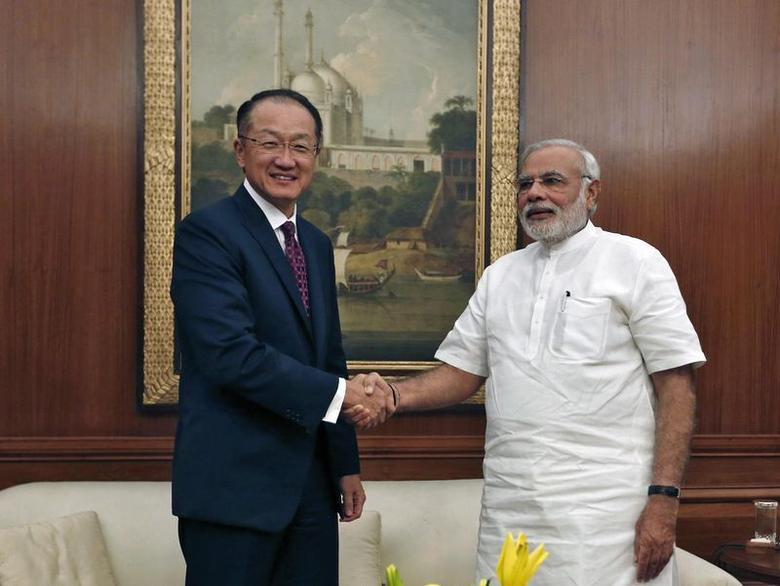 World Bank President Jim Young Kim (L) and Prime Minister Narendra Modi shake hands before their meeting in New Delhi July 23, 2014. REUTERS/Adnan Abidi
