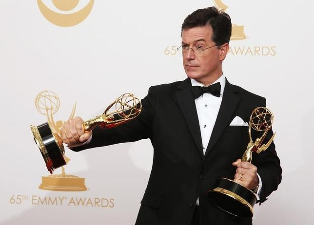 Stephen Colbert  poses backstage with his awards for Outstanding Variety Series and Outstanding Writing For A Variety Series at the 65th Primetime Emmy Awards in Los Angeles September 22, 2013. REUTERS/Lucy Nicholson