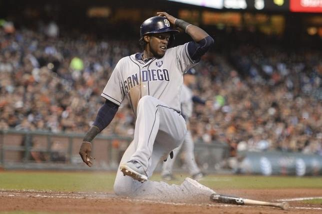 San Diego Padres center fielder Cameron Maybin (24) scores on a ground out by right fielder Will Venable (25, not pictured) against the San Francisco Giants during the fifth inning at AT&T Park. June 24, 2014; San Francisco, CA, USA; Kyle Terada-USA TODAY Sports