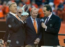 Denver Broncos executive John Elway and owner Pat Bowlen celebrate the 26-16 victory against the New England Patriots following the 2013 AFC Championship football game at Sports Authority Field at Mile High. January 19, 2014; Denver, CO, USA;Mark J. Rebilas-USA TODAY Sports