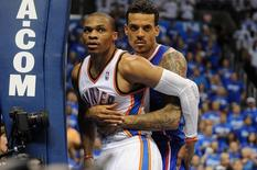 Los Angeles Clippers forward Matt Barnes (22) fouls Oklahoma City Thunder guard Russell Westbrook (0) on a shot attempt during the fourth quarter in game two of the second round of the 2014 NBA Playoffs at Chesapeake Energy Arena. May 7, 2014; Oklahoma City, USA; Mark D. Smith-USA TODAY Sports