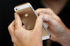 The gold colored version of the new iPhone 5S is seen after Apple Inc's media event in Cupertino, California September 10, 2013. REUTERS/Stephen Lam
