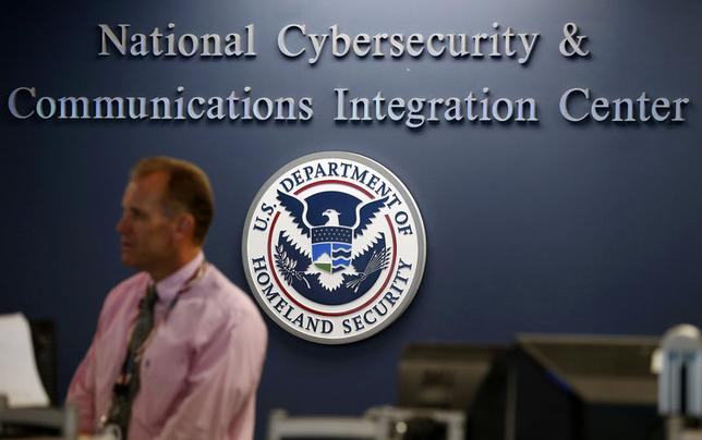 A U.S. Department of Homeland Security employee stands inside the National Cybersecurity and Communications Integration Center as part of a guided media tour in Arlington, Virginia June 26, 2014. REUTERS/Kevin Lamarque