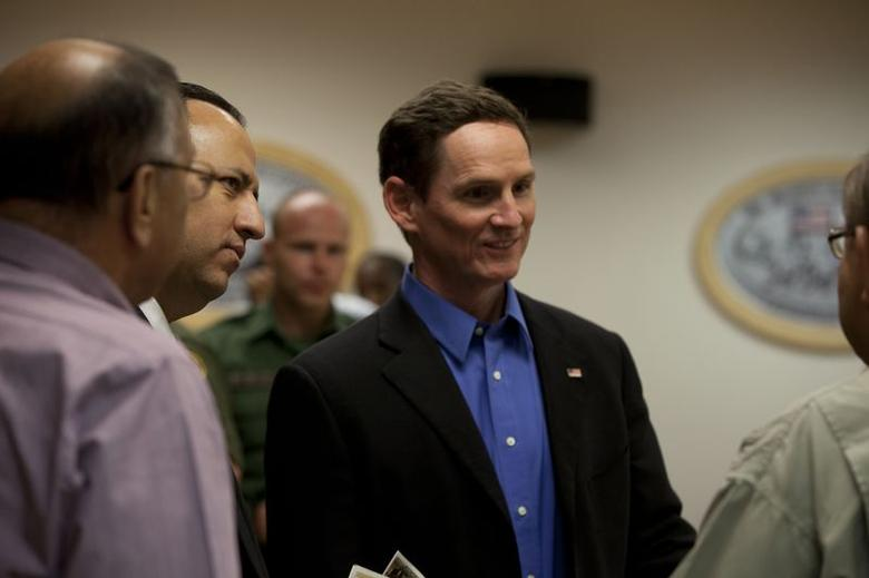 Judge Clay Jenkins speaks to Customs and Border control at the border at McAllen, Texas, in this handout photo taken July 2, 2014, courtesy of Dallas County.  REUTERS/Dallas County/Handout via Reuters