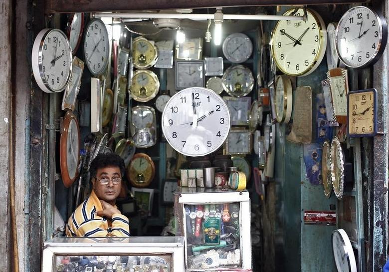 A shopkeeper waits for customers at his shop selling wall clocks in the old quarters of Delhi November 12, 2013. REUTERS/Anindito Mukherjee