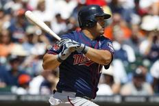 Minnesota Twins designated hitter Kendrys Morales (17) hits an RBI single in the sixth inning against the Detroit Tigers at Comerica Park. Jun 15, 2014; Detroit, MI, USA;  Rick Osentoski-USA TODAY Sports