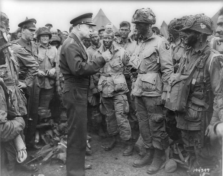 Allied forces Supreme Commander General Dwight D. Eisenhower speaks with U.S. Army paratroopers of Easy Company, 502nd Parachute Infantry Regiment (Strike) of the 101st Airborne Division, at Greenham Common Airfield in England June 5, 1944 in this handout photo provided by the US National Archives.  REUTERS/US National Archives/Handout via Reuters