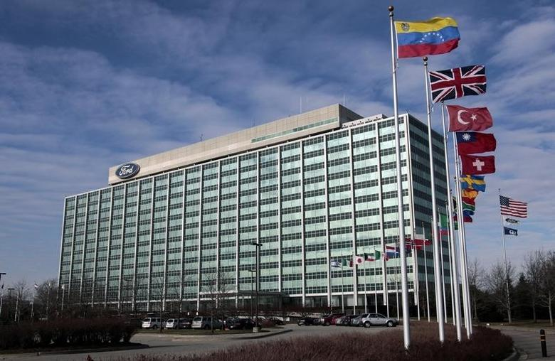 International flags fly along side the U.S. flag in front of the Ford Motor Co. headquarters in Dearborn, Michigan December 16, 2009.  REUTERS/Rebecca Cook