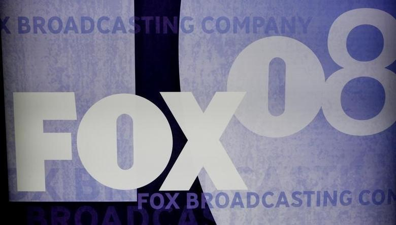 The Fox logo is pictured on signage at the Fox TV network summer press tour in Beverly Hills, California  July 14,  2008.  REUTERS/Fred Prouser/Files