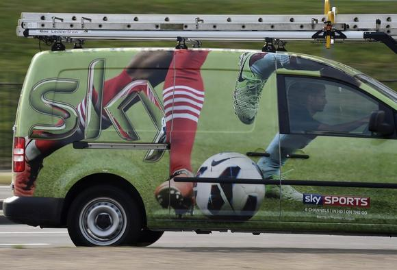 A British Sky Broadcasting Group (BSkyB) work van is driven in west London July 25, 2014. REUTERS/Toby Melville