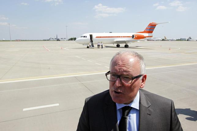 Dutch Foreign Minister Frans Timmermans talks to journalists during his visit to Kharkiv airport as remains of passengers of downed Malaysia Airlines Flight MH17 airliner are loaded into a plane (not pictured), in Kharkiv July 25, 2014. REUTERS/Valentyn Ogirenko