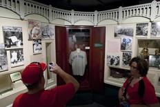 Visitors look at the jersey of baseball great Babe Ruth displayed in a Yankee Stadium locker at the National Baseball Hall of Fame in Cooperstown, New York, July 21, 2012. REUTERS/Adam Fenster