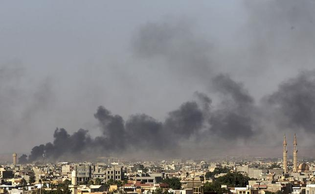 Black plumes of smoke is seen in the vicinity of Camp Thunderbolt, after clashes between militants, former rebel fighters and government forces in Benghazi July 26, 2014. REUTERS/Esam Omran Al-Fetori